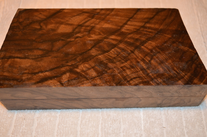 (8) French Walnut. Rich brown tones with fine marbled streaks and feathering.