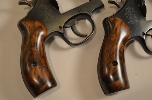 (1) These two S&W 24s wear Turkish Walnut cut from the same block. The grain and color are a fine match and the result is a great pair.